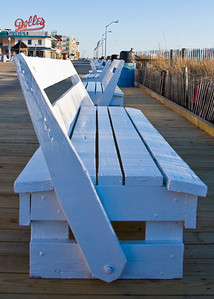 These benches line the edge of the boardwalk.  They are built so you can turn the back to either face the water during the day or the boardwalk at night.  I like this shot, they seem to go on forever.