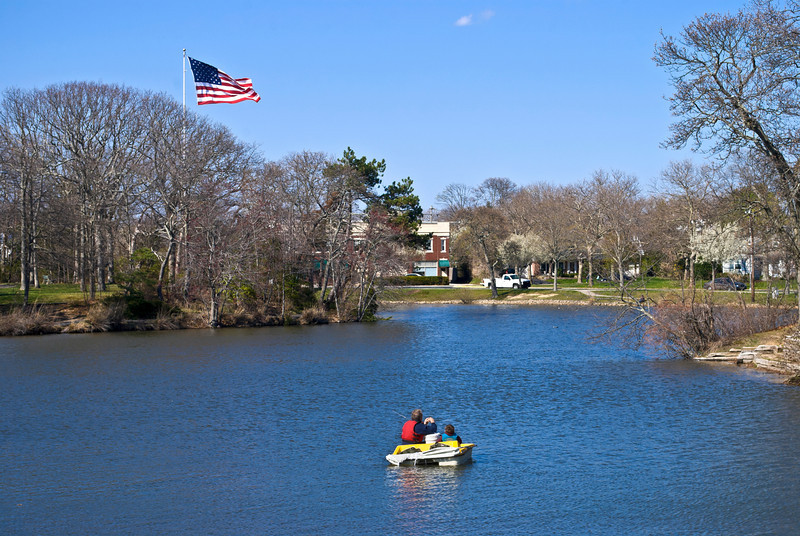 A father and son fishing on the lake in Spring Lake, along the Jersey shore.