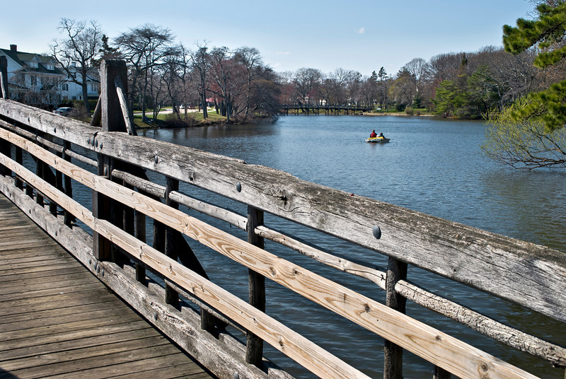 A view from the wooden footbridge in Spring lake on a quiet Spring Sunday afternoon.
