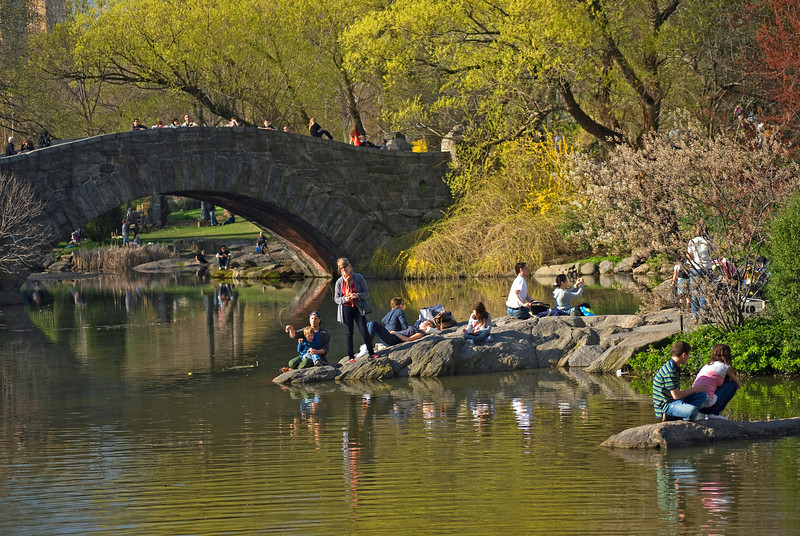 """Enjoying Central Park""<br /> People enjoying an early Spring day by the duck pond in Central Park."