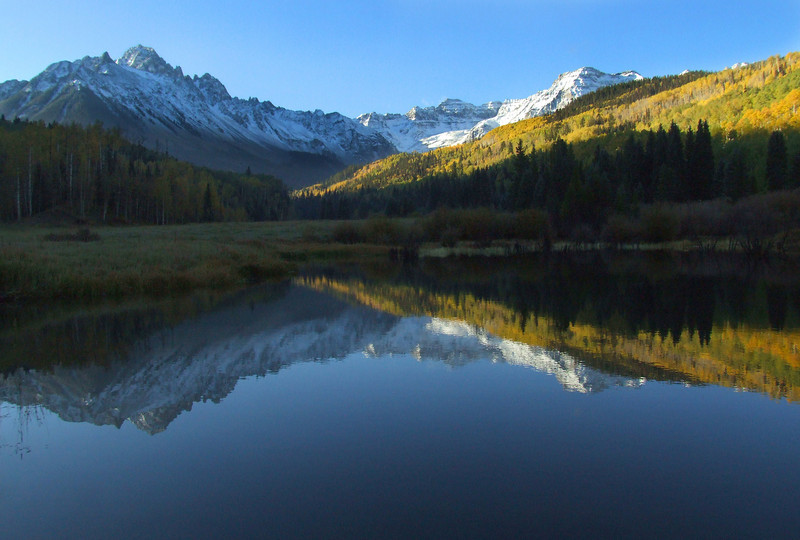 Mount Sneffels reflects in a beaver pond near the Blue Lakes trailhead
