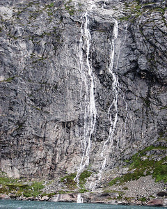 Waterfall, glacier melt in Prins Christian fjord, Greenland