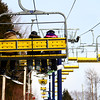 Snowboarders & Skier Family on Chairlift