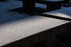 Light and shadow; snow on concrete