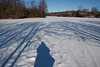 Shadow self-portrait; Furstenberg Lagoon.<br /> <br /> A couple of weeks of unseasonably arctic cold had frozen the calm shallow waters of the lagoon to the point that I felt safe walking out on the ice.  A skating rink had been cleared of snow earlier in the week, but was dusted over with fresh snow, and I was the only one out on the ice this morning.<br /> <br /> January 23, 2011.