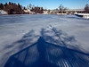 My shadow cast on the ice, with Geddes Dam in the distance.<br /> <br /> Gallup Park, Ann Arbor<br /> February 9, 2013