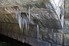 Icicles hanging inside the arch of the railroad underpass through which flows Fleming Creek.<br /> <br /> Forest Park, Washtenaw County, Michigan .<br /> January 15, 2012