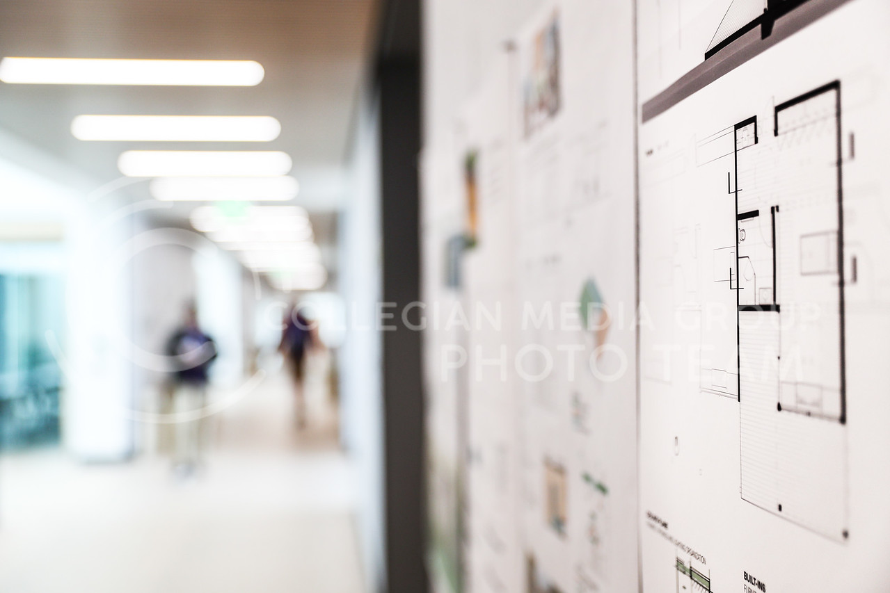 Architecture and planning students hang their work in the hallways of Seaton Hall. (Photo by Cooper Kinley | Collegian Media Group)