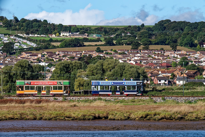 Tram No. 10, heading for Seaton passes Tram No. 9, heading for Colyford, <br /> in the Axmouth Loop, on 30th September 2016.