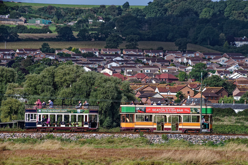Tram No. 8, heading for Seaton passes Tram No. 10, heading for Colyford, <br /> in the Axmouth Loop, on 25th September 2016.