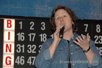 Lifelong AIDS Alliance's Executive Director at Superhero Gay Bingo fundraiser 13 January, 2006 in Seattle, WA