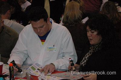 Frank studies the BINGO card at Lifelong AIDS Alliance's Superhero Gay Bingo fundraiser 13 January, 2006 in Seattle, WA