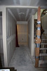Stairwell and hallway to Roy's room, utility room, and guest bedroom.