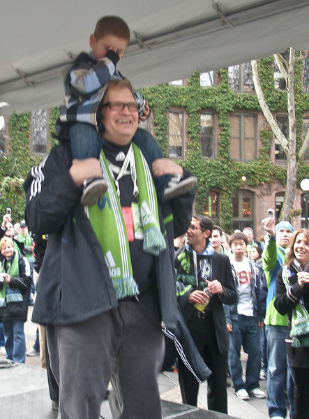 March 19 2009  Inaugural Season Opening Match: Seattle Sounders vs New York Red Bulls<br /> Seattle 3- New York 0<br /> Drew Carey, a minority owner of the SFC, and his little guy at the pep rally @ Pioneer Square.