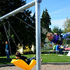 Yellow swing at Colman Playground/Children's Playgarden.  Do their faces show enough that you need to get permission via Liz Bullard from parents?