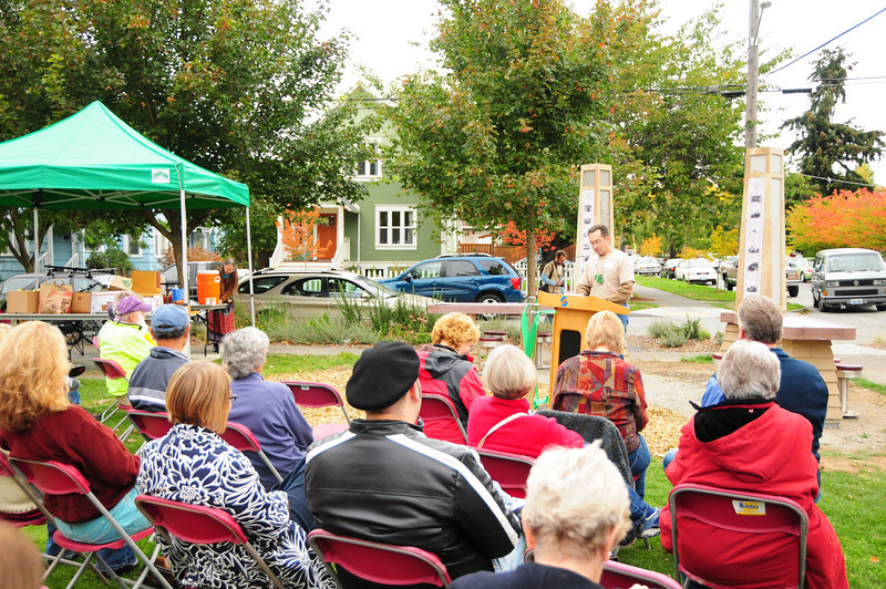 David Folweiler, cochair of Friends of Ballard Corners Park, emceed the event