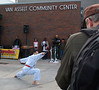 Vovinam, martial arts demonstration. On the right, video artist Christopher Brown creates a video about Starbucks partnerships with Seattle Parks.
