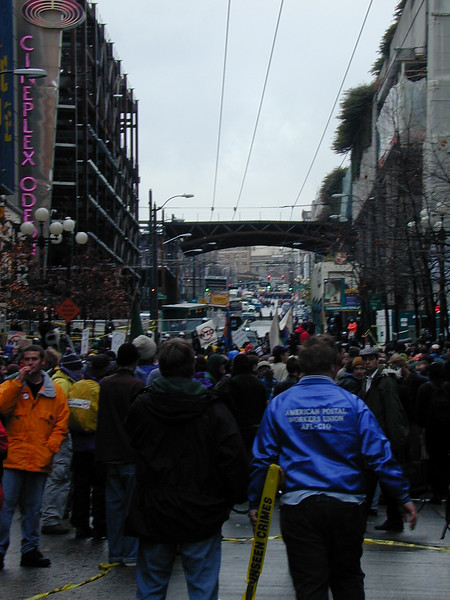 Looking up Pike, with the Sheraton and convention center on the right. Lines of riot police can be seen up the hill.