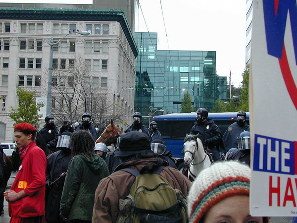 The cops look ready, though the crowd (including me) still seem mostly unaware of what is about to happen.