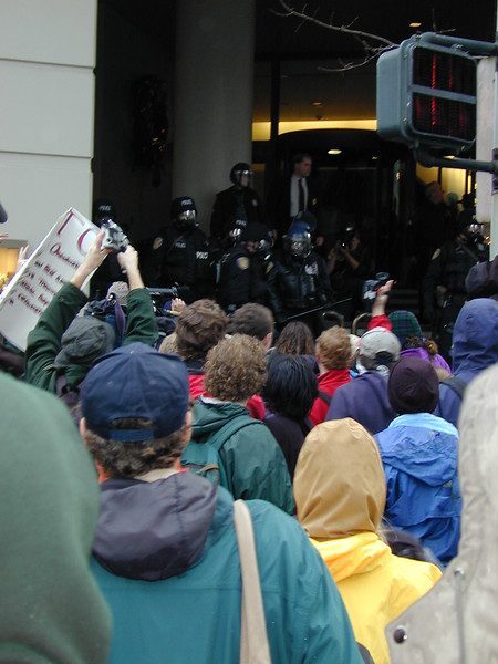 Police trying to keep protesters out of the Sheraton while trying to let WTO attendees in.