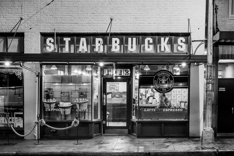 Reputed to be the original Starbucks store, this small storefront is located on Pike Place, directly across from Pike Place Market.  This was a very early morning image.  During most of the day many people wait in line to experience the first store!