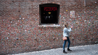 visitor, at the gum wall