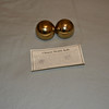 a pair of brass balls<br /> <br /> Photographer's Name: John  Burke
