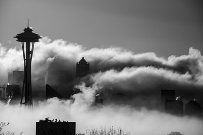 Morning fog from Kerry Park.  I later noticed the silhouettes of the people in the foreground.   Photographer's Name: Kyle Wasielewski