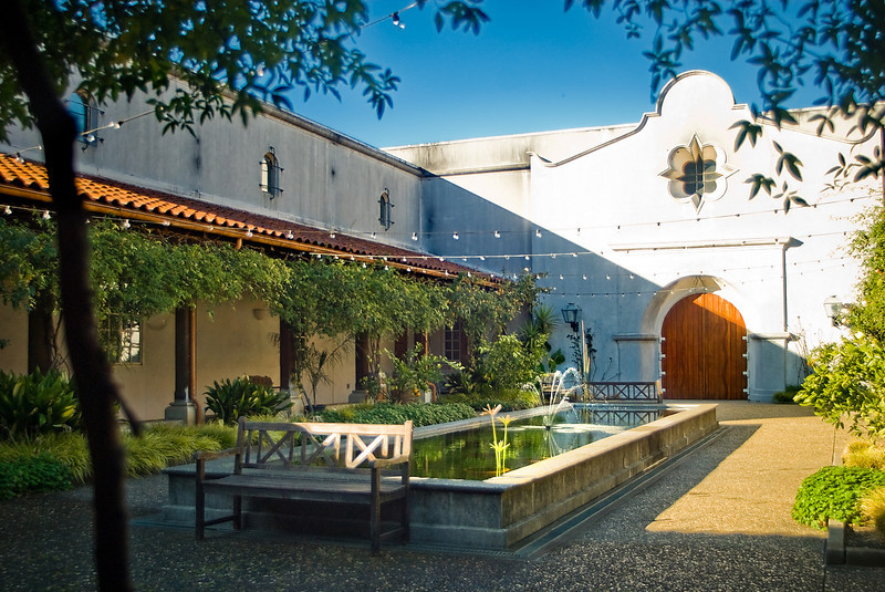 <b>INSIDE THE WINERY:</b>  After passing through the arched gateways, you pass through this courtyard and you instantly begin to relax - even before drinking the wine.