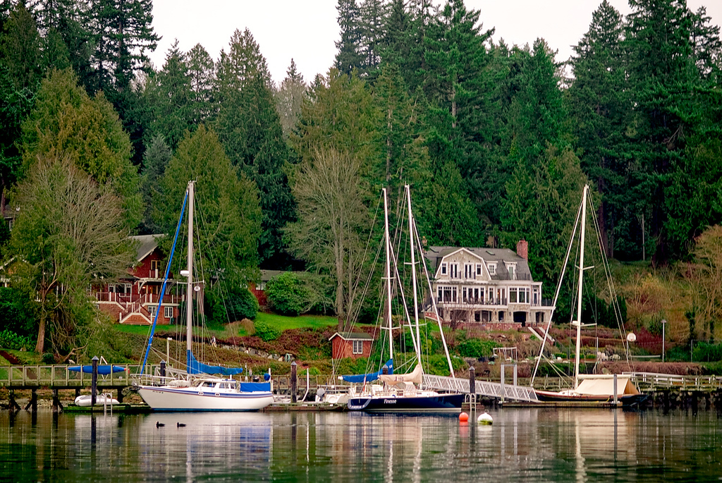 <b>A VIEW OF BAINBRIDGE ISLAND:</b>  The inlets along the island are lined with cozy beach houses and sail boats.  Even on a gray day, it looks inviting.  Here is a typical view while traveling the water ways around the island.  More trip pics coming soon...!