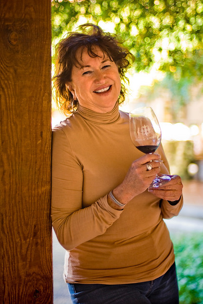 <b>MY TRAVEL COMPANION:</b>  Here, Ruth enjoys some shade while sampling one of the varieties of wine.  Even though the temperatures this time of year can get chilly, this particular day in January was quite warm while standing in the sun, so the shade was welcome.