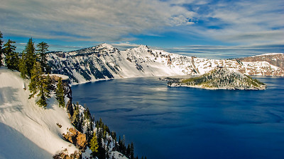 CRATER LAKE, Oregon:  After driving well into the night, the next opportunity that I had to take photographs was in Crater Lake, Oregon.  This is a national park that features a volcano that blew it's top 7000 years ago. It left a giant cauldera which eventually filled with water.  The lake is quite large and is almost 2000 feet deep.  But the water clarity is amazing - around a 100 feet of visibility.  The record is 140 feet of visibility.  This shot only shows about one third of the entire lake.