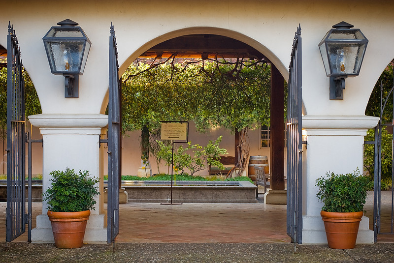 <b>ENTERING THE WINERY:</b>  A simple gated arch entry into the winery which leads to a cozy courtyard...