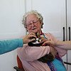 HOLLY PELCZYNSKI - BENNINGTON BANNER Joan Walsh of Pownal Vermont cuddles a 4 month old kitten named Clark during a visit from Second Chance animal Center at Bennington Project Independance  on Wednesday morning.