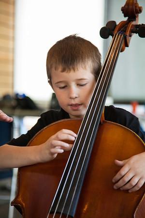 Second Grade Music Class Playing Bass