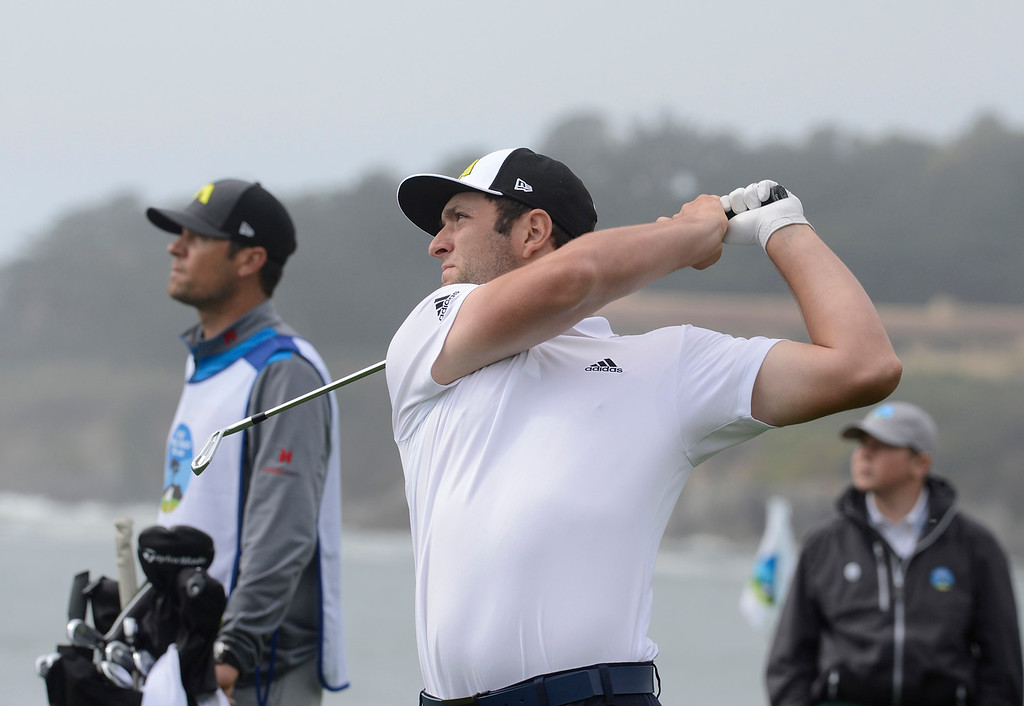 . Jon Rahm tees off on the fifth hole at Pebble Beach Golf Links during the second round of the AT&T Pebble Beach Pro-AM in Pebble Beach on Friday February 10, 2017. (David Royal - Monterey Herald)