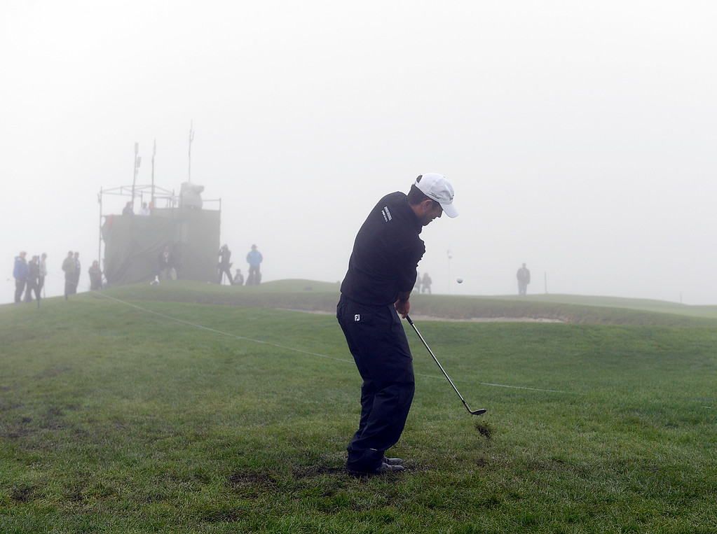 . Robert Streb chips his ball from off course onto the sixth green just before a delay of play due to heavy fog at Pebble Beach Golf Links during the second round of the AT&T Pebble Beach Pro-AM in Pebble Beach on Friday February 10, 2017. (David Royal - Monterey Herald)