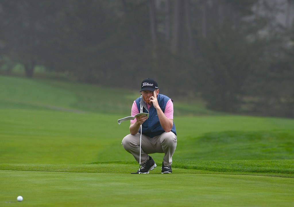 . Derek Fathauer lines up his putt as a heavy fog rolls in behind him on the thirteenth green at Pebble Beach Golf Links during the second round of the AT&T Pebble Beach Pro-AM in Pebble Beach on Friday February 10, 2017. (David Royal - Monterey Herald)