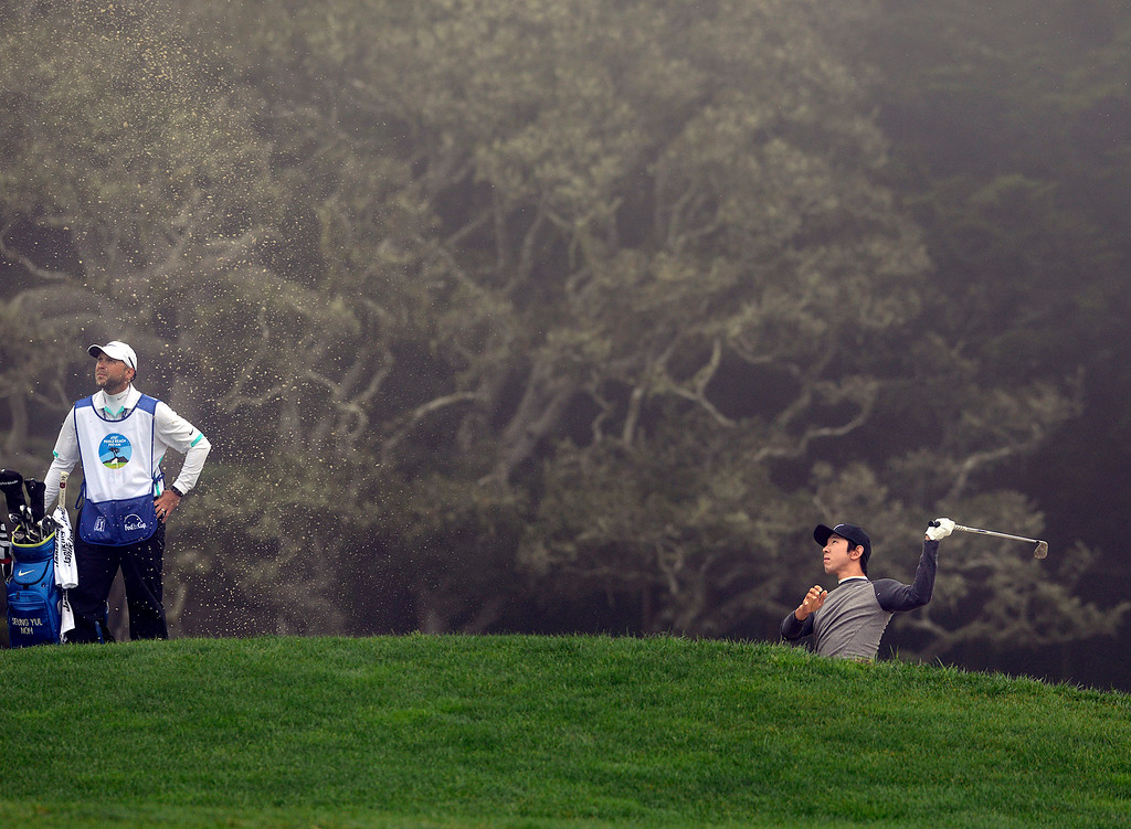 . Seung-Yul Noh hits his ball from a bunker on the thirteenth fairway at Pebble Beach Golf Links during the second round of the AT&T Pebble Beach Pro-AM in Pebble Beach on Friday February 10, 2017. (David Royal - Monterey Herald)
