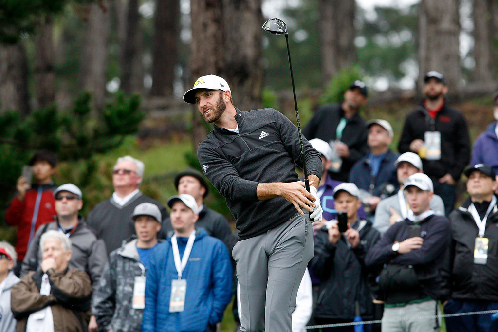 . Dustin Johnson tees off on the eleventh hole at Spyglass Hill during the second round of the AT&T Pebble Beach Pro Am on Friday, Feb. 10, 2017.   (Vern Fisher - Monterey Herald)
