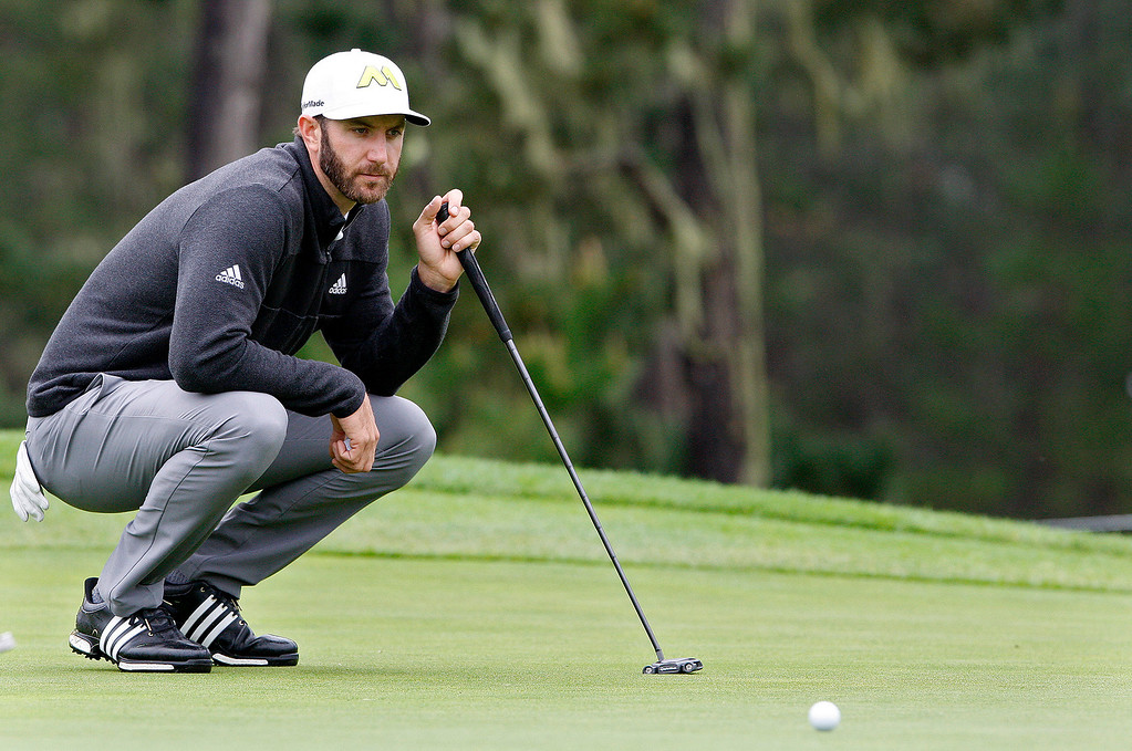 . Dustin Johnson lines up a putt on the tenth hole at Spyglass Hill during the second round of the AT&T Pebble Beach Pro Am on Friday, Feb. 10, 2017.   (Vern Fisher - Monterey Herald)