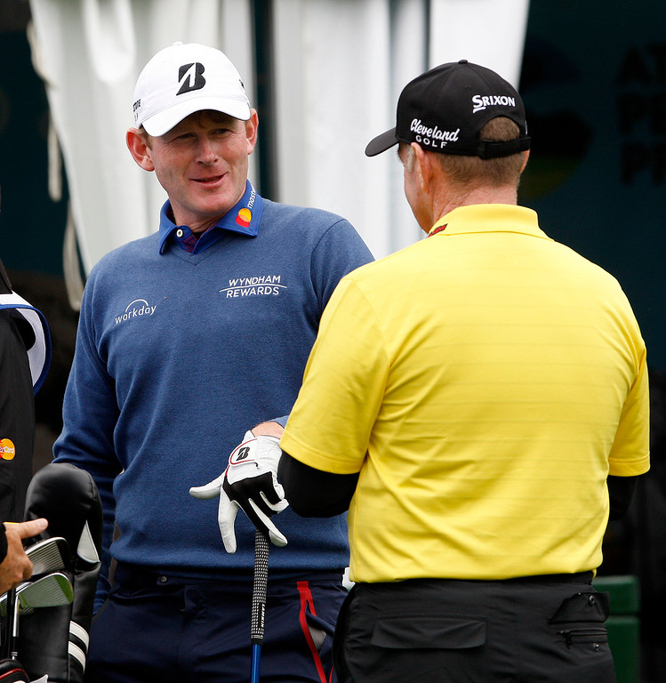 . Brandt Snedeker talks with Rod Pampling on the first hole at Spyglass Hill during the second round of the AT&T Pebble Beach Pro Am on Friday, Feb. 10, 2017.   (Vern Fisher - Monterey Herald)