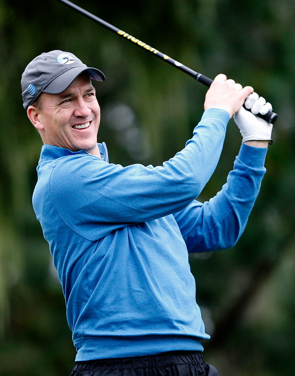 . Peyton Manning watches his tee shot from the tenth hole at Spyglass Hill during the second round of the AT&T Pebble Beach Pro Am on Friday, Feb. 10, 2017.   (Vern Fisher - Monterey Herald)