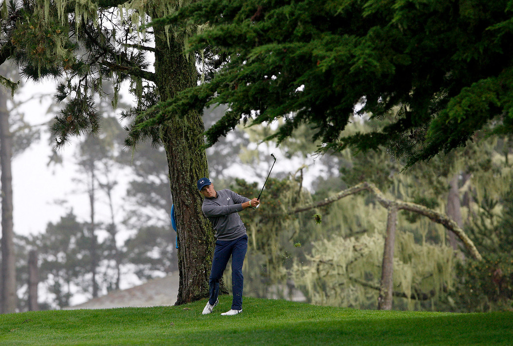 . Jordan Spieth hits his second shot on the tenth hole at Spyglass Hill during the second round of the AT&T Pebble Beach Pro Am on Friday, Feb. 10, 2017.   (Vern Fisher - Monterey Herald)