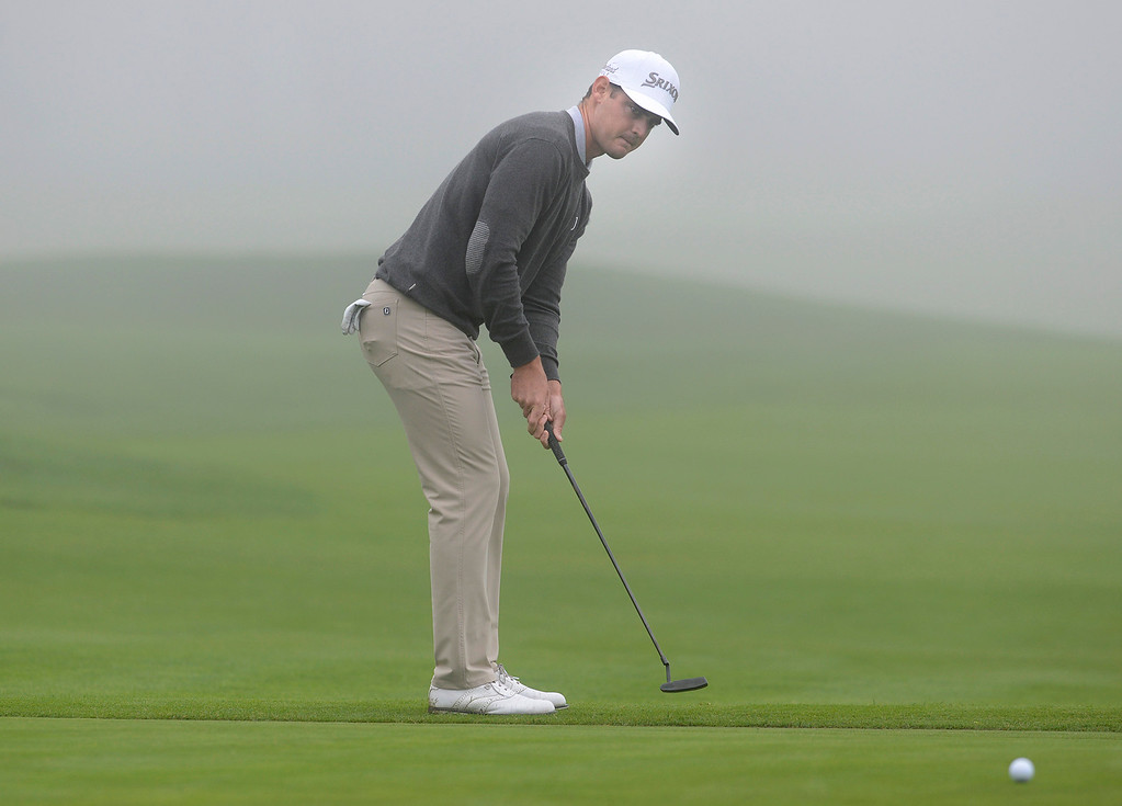 . Rick Lamb hits his ball on the thirteenth green as a heavy fog rolls in at Pebble Beach Golf Links during the second round of the AT&T Pebble Beach Pro-AM in Pebble Beach on Friday February 10, 2017. (David Royal - Monterey Herald)