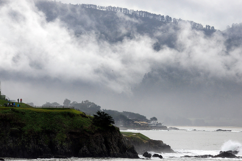 . Clouds hang over the seventh hole at Pebble Beach Golf Links during the second round of the AT&T Pebble Beach Pro-AM in Pebble Beach on Friday February 10, 2017. (David Royal - Monterey Herald)
