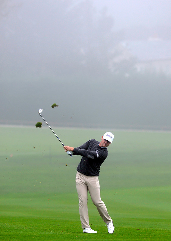 . Rick Lamb hits his ball on the thirteenth fairway as a heavy fog rolls in at Pebble Beach Golf Links during the second round of the AT&T Pebble Beach Pro-AM in Pebble Beach on Friday February 10, 2017. (David Royal - Monterey Herald)
