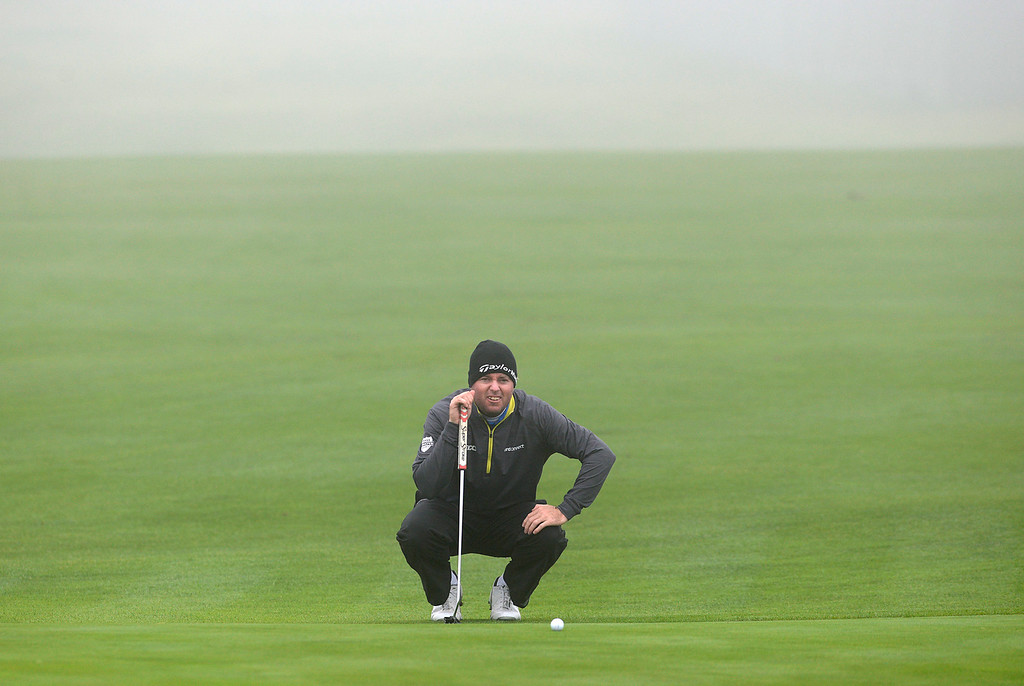 . Robert Garrigus squints on the sixth green just before a delay of play for fog at Pebble Beach Golf Links during the second round of the AT&T Pebble Beach Pro-AM in Pebble Beach on Friday February 10, 2017. (David Royal - Monterey Herald)