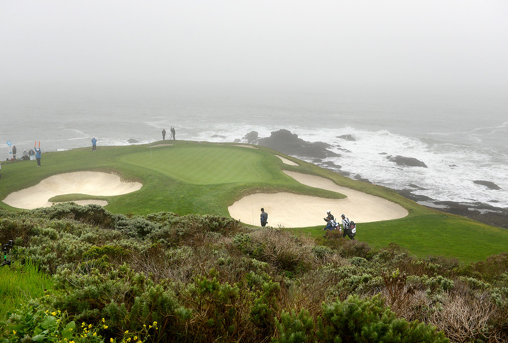 . Robert Streb\'s playing group walk to their balls on the seventh green after a delay of play due to heavy fog at Pebble Beach Golf Links during the second round of the AT&T Pebble Beach Pro-AM in Pebble Beach on Friday February 10, 2017. (David Royal - Monterey Herald)