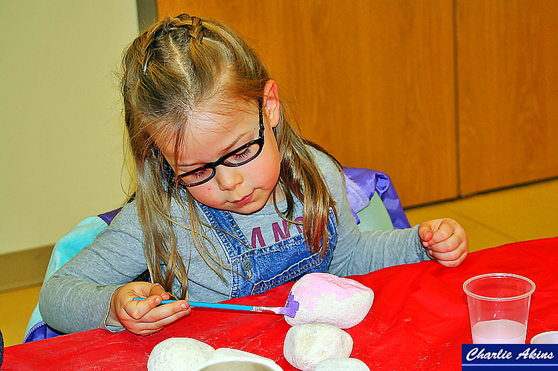 This girl enjoyed painting rocks.